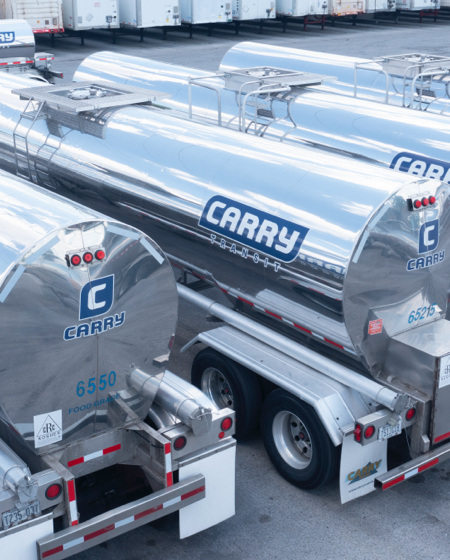 Four Carry Transit trucks parked next to each other